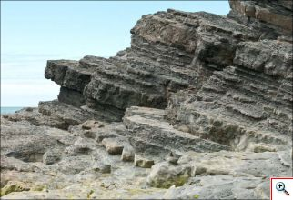 Figure 4: Layered turbidite deposits at Clarach Bay, Aberystwyth, UK. Image credit: Derek Pullan